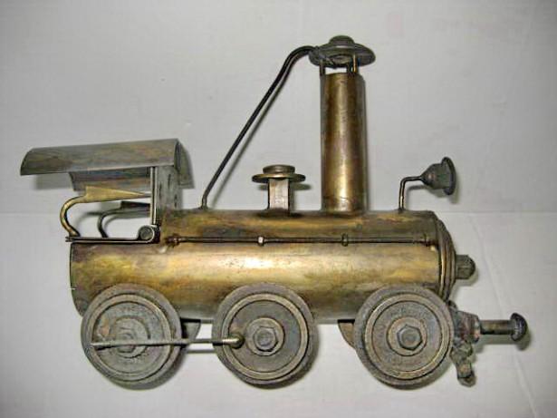 Locomotova tren colectie metal manual executata in stare foarte buna. Metal masiv- 1.8 kg. Marimi: i